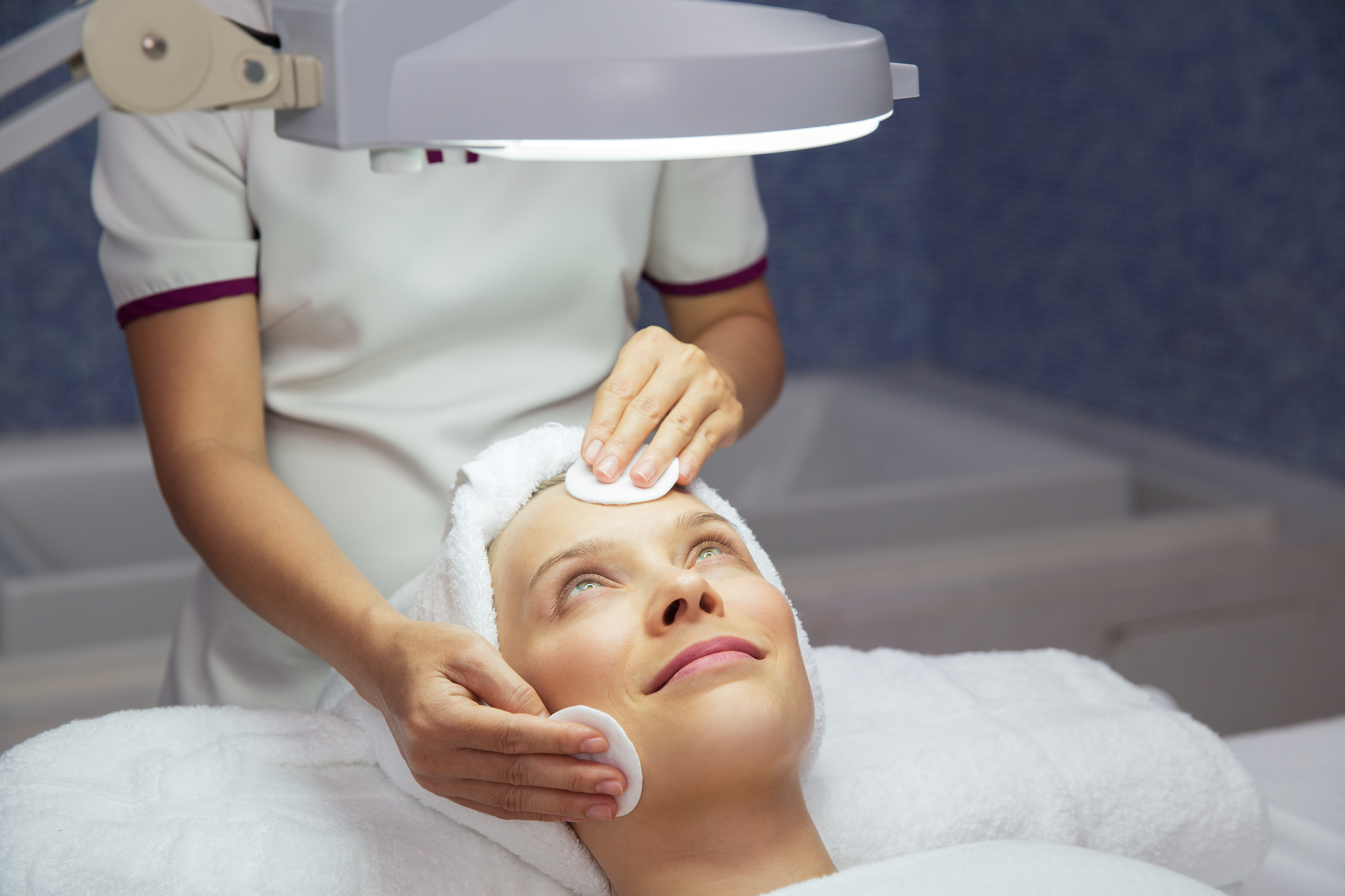 Woman Getting Facial Treatment in Beauty Salon